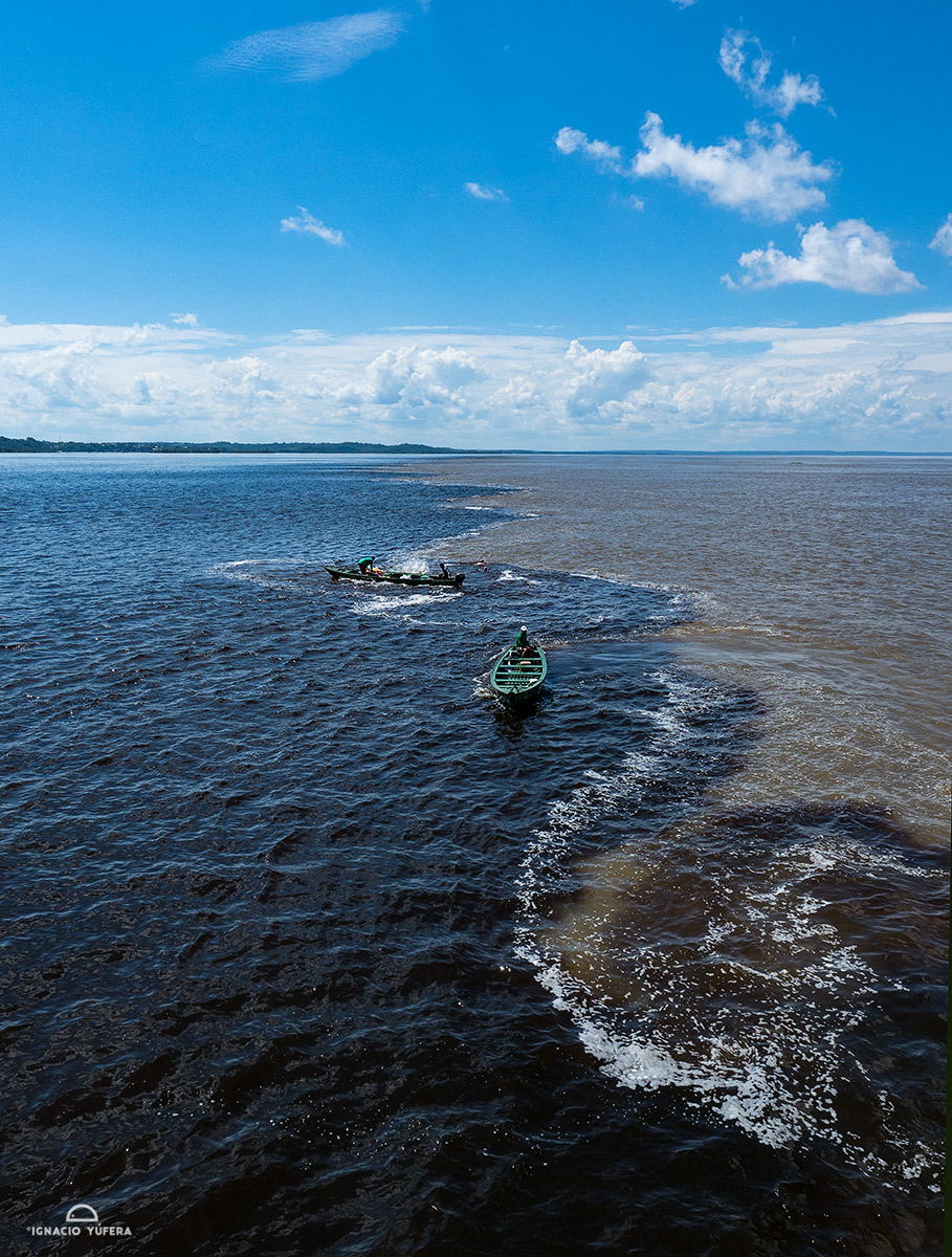 Meeting waters: the Amazon and Rion Negro rivers meet near Manaus, Brazil